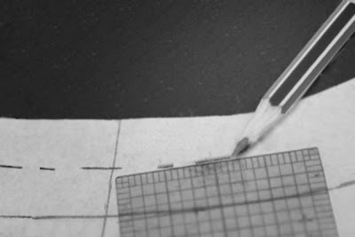Add seam allowance to a curve by using a ruler at 1/2 inch and mark spots with pencil