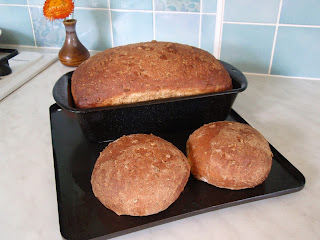 Bread standing for 5 minutes before being removed from tin.