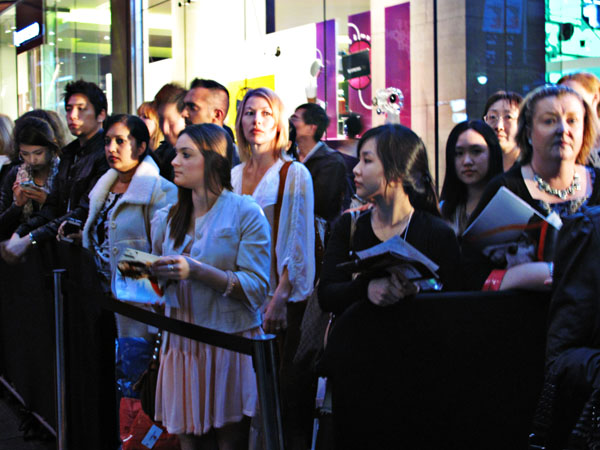 People looking on for the launch of Sydney Vogue Fashion's Night Out 2011