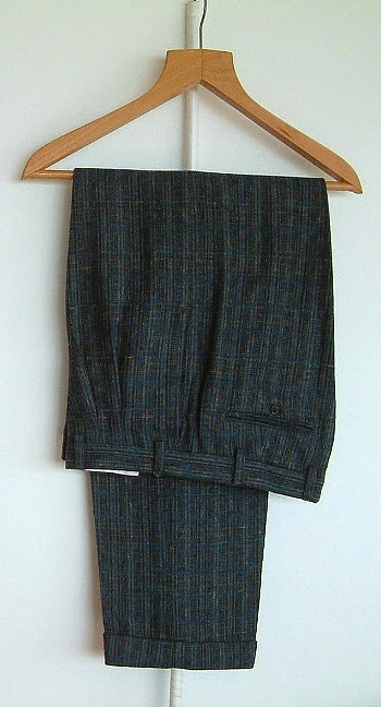 1980s fleck trousers with twin pleats, tapered legs and turn-ups
