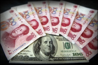 image of several chinese yuan bills over an american 100 dollar bill
