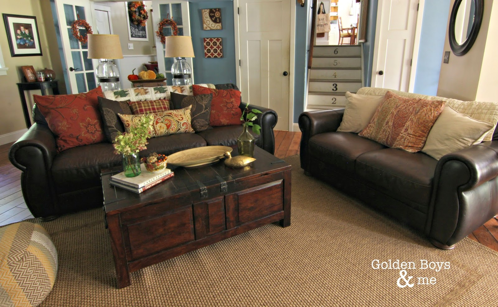 Brown leather furniture in family room with jute rug and trunk style coffee table-www.goldenboysandme.com