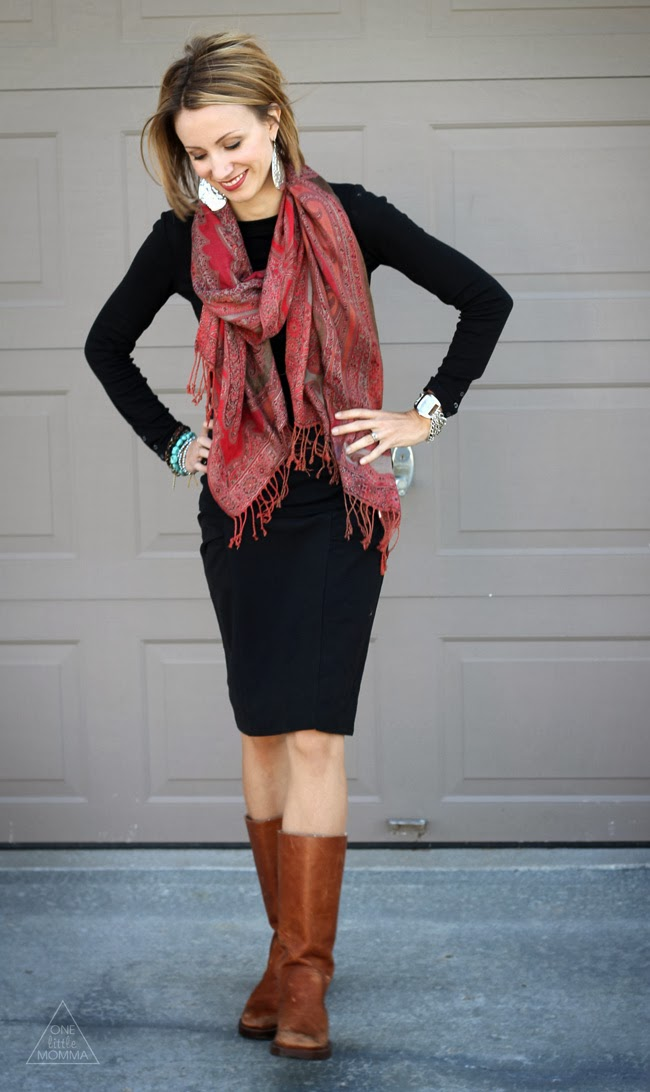 Dark lip, all black with brown boots and a red fringe scarf