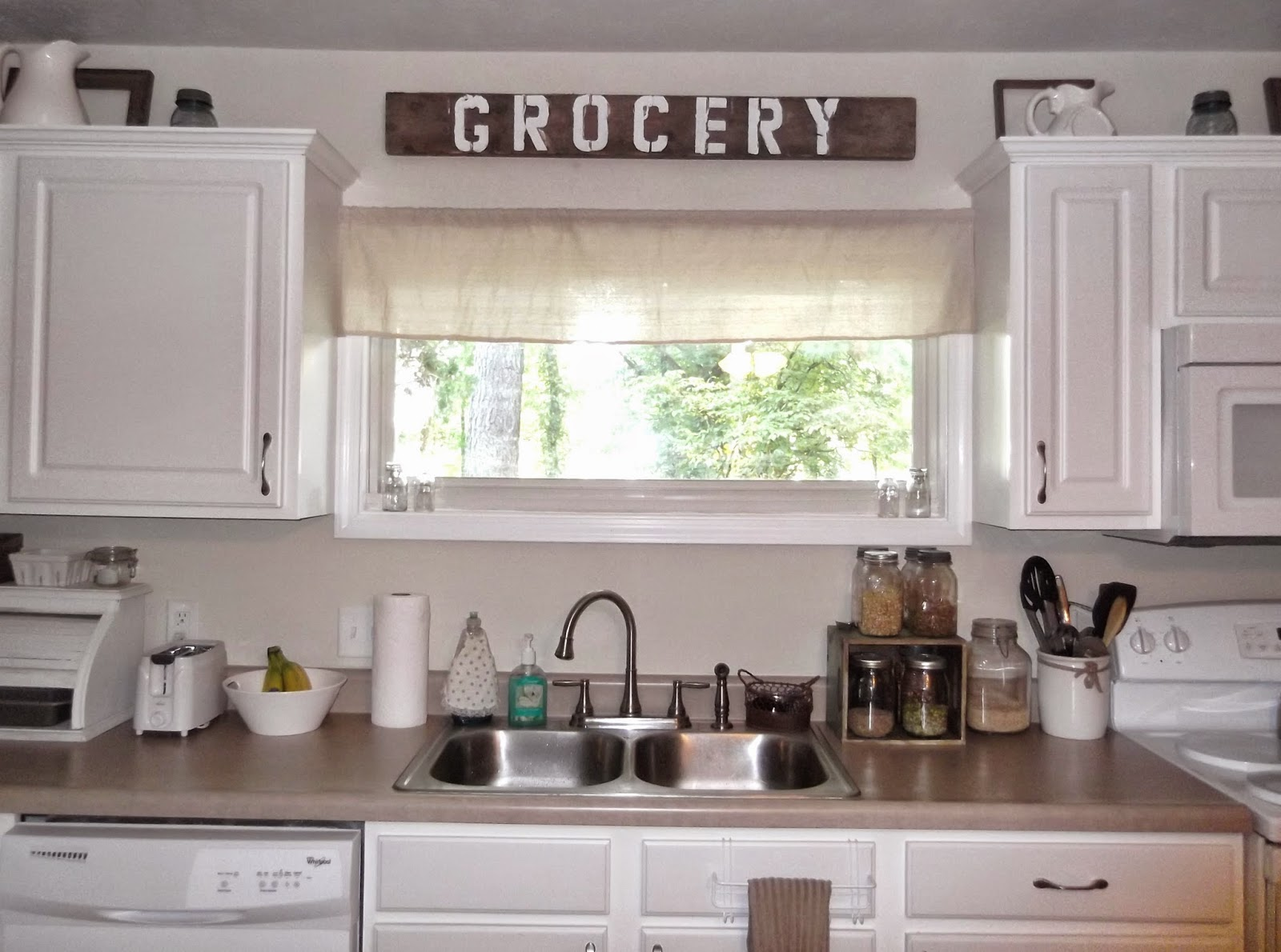 i found an over the cabinet towel bar that works great for those faux drawers by the kitchen sink i cant remember where i got this one but have seen them : sink windows window love