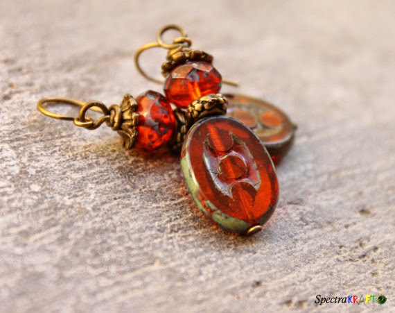 https://www.etsy.com/listing/169678056/earthy-orange-earrings-picasso-earrings?ref=shop_home_active_21