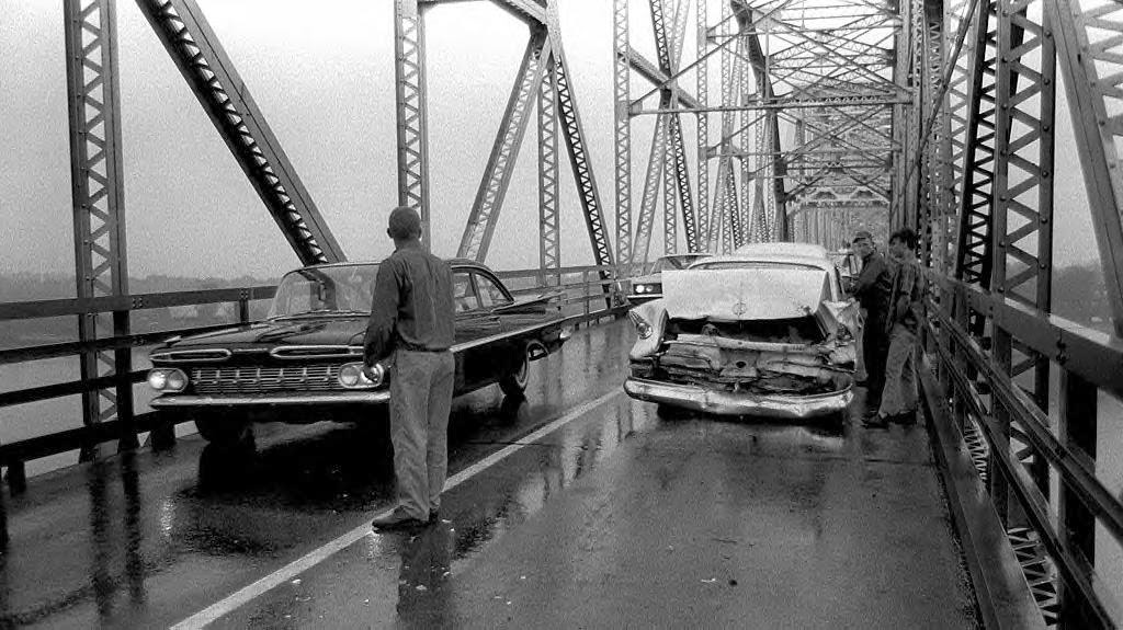 Circa 1960 Chrysler rear-ended on a bridge.