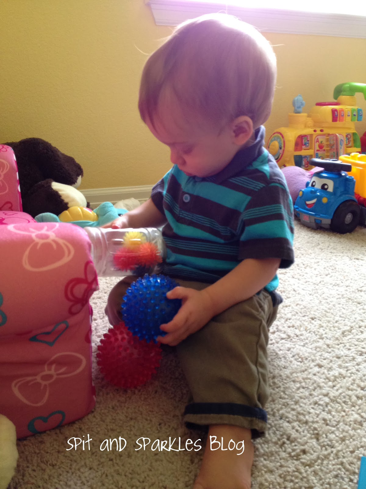 Tot school for one year olds- gather up a bunch of the same toy of different sizes, colors, textures and explore. Take turns saying the name of the toy to learn object recognition. #totschool #homeschool