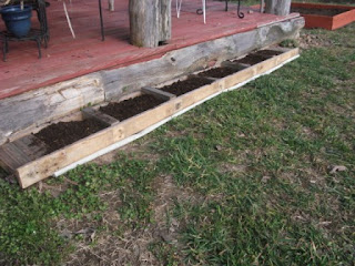 Upcycled Mattress frame turned herb garden bed