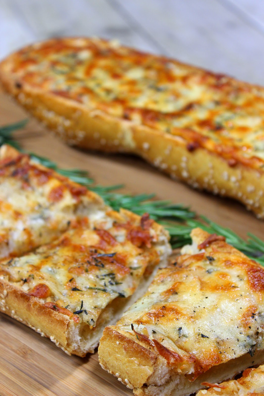 Roasted Garlic Rosemary Cheese Bread works equally well as a delicious appetizer, side dish or meatless entree.