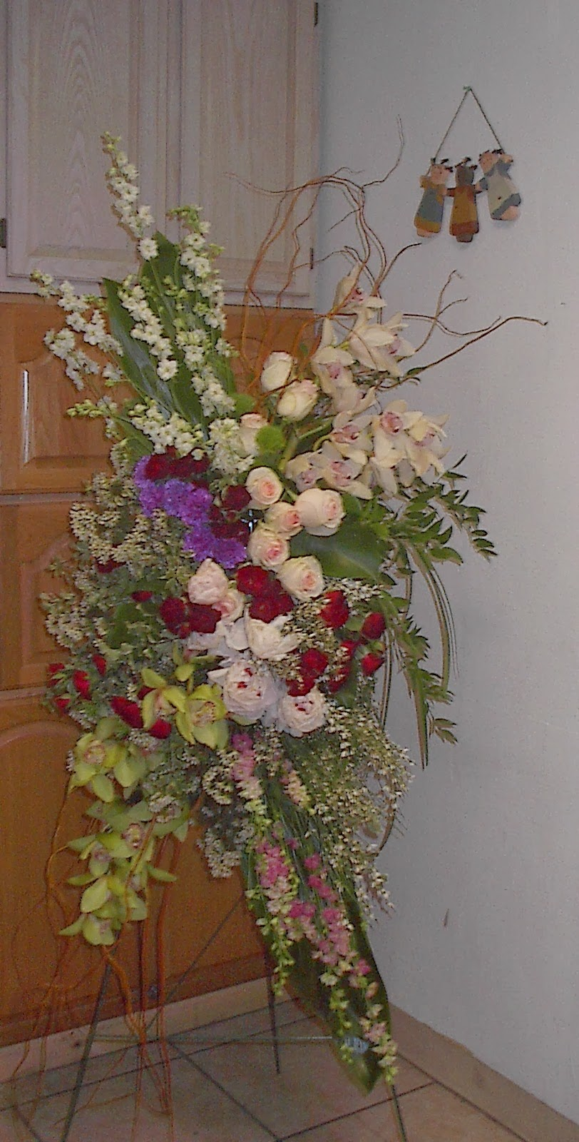 Funeral flowers in las vegas las vegas flowers premier event florists curly willow beautiful amber curly willow with italian ruscus so pretty izmirmasajfo