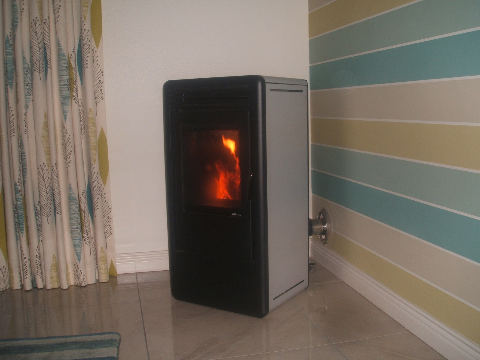 Green energy technology wood pellet stoves by mcz - Pellet stoves for small spaces set ...