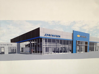 on the road with zoom chevy trucks pull down building at john watson chevrolet. Cars Review. Best American Auto & Cars Review