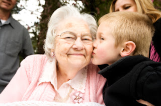older woman in senior care home with her grandson