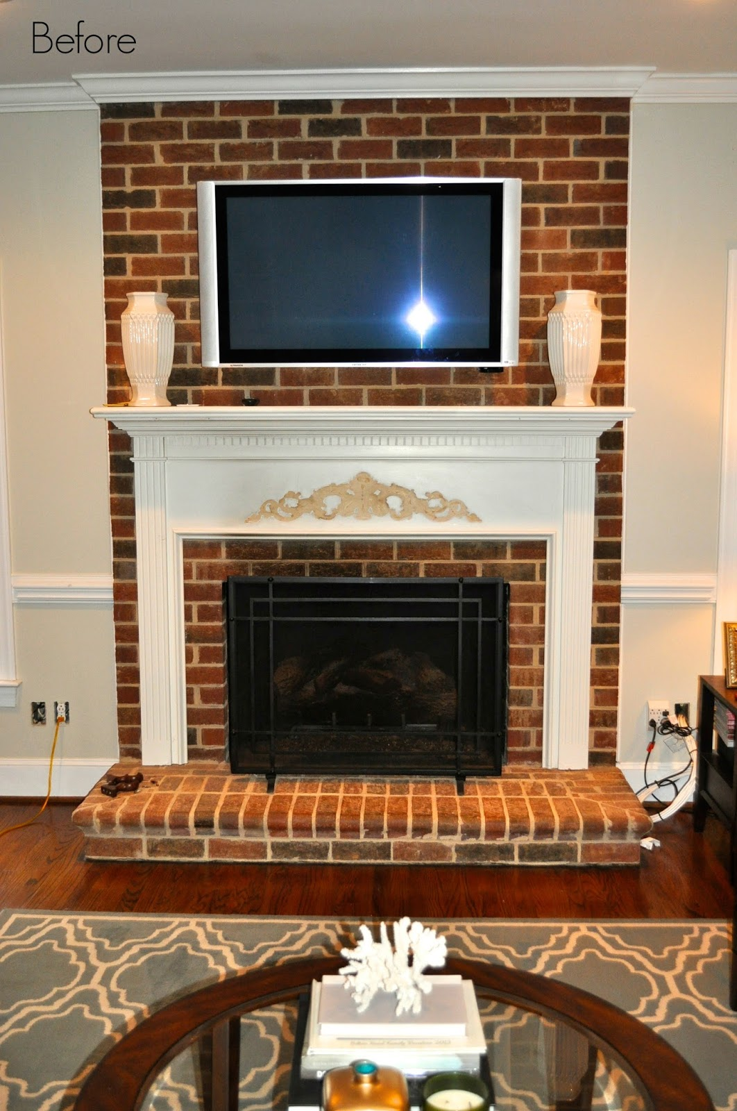 the collected interior: painted brick fireplace…before & after!