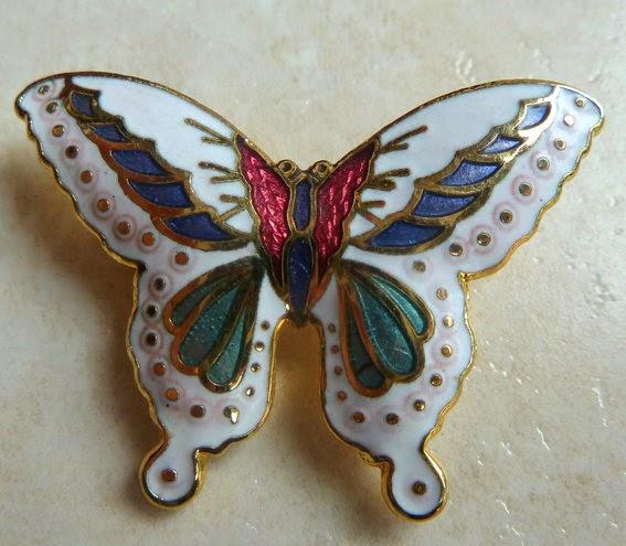 http://www.kcavintagegems.uk/vintage-enamel-white-butterfly-brooch-133-p.asp