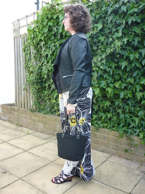 Side view of Maxi Dress and Faux Leather Jacket