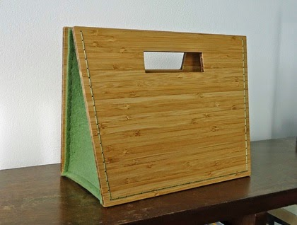 http://felt.co.nz/listing/165231/Bamboo-and-wool-felt-clutch-handbag