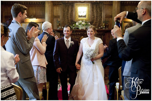 just married, bride and groom, ellingham hall, ellingham hall wedding, northumberland wedding photographer, newcastle wedding photographer, ceremony signs, paper pom poms, quirky wedding photography, katie byram photography, diy wedding