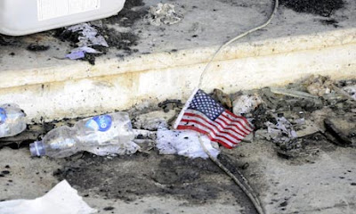 A US flag lies amid the rubble at the US consulate in Benghazi, Libya, where diplomat Chris Stevens and three others were killed on 11 September. Photograph: Stringer/EPA
