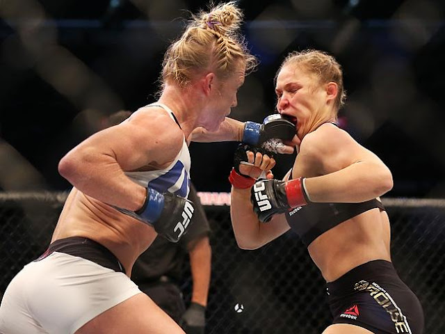 Ronda Rousey eats a punch from Holly Holm during their UFC 193 fight.Source: Getty Images