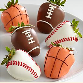 ... across these adorable sports themed chocolate covered strawberries