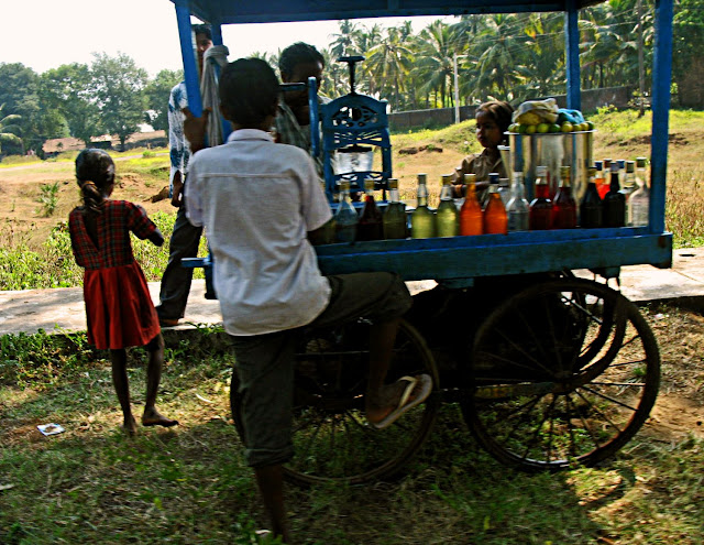children consuming coloured synthetic drinks in India