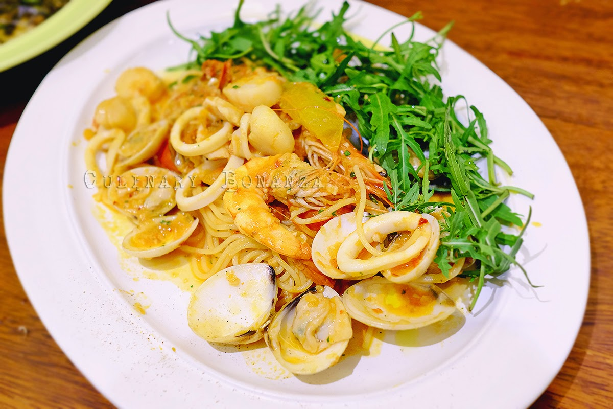 Spaghettini Pescatore - served with tomato sauce, topped with tiger shrimp, clams, green mussels and squid
