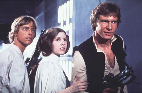 Carrie Fisher as Princess Leia, Mark Hamill as Luke Skywalker, Harrison Ford as Han Solo, Star Wars movieloversreviews.blogspot.com