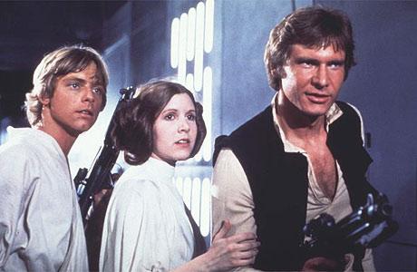Carrie Fisher as Princess Leia, Mark Hamill as Luke Skywalker, Harrison Ford as Han Solo, Star Wars movieloversreviews.blogspot.com