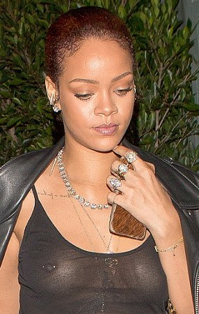 rihanna shows her nipple piercing as she goes out without