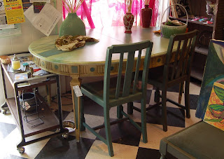 Four chairs have been painted to match the tree table. Three are shown. Photo credit: Amy Williams