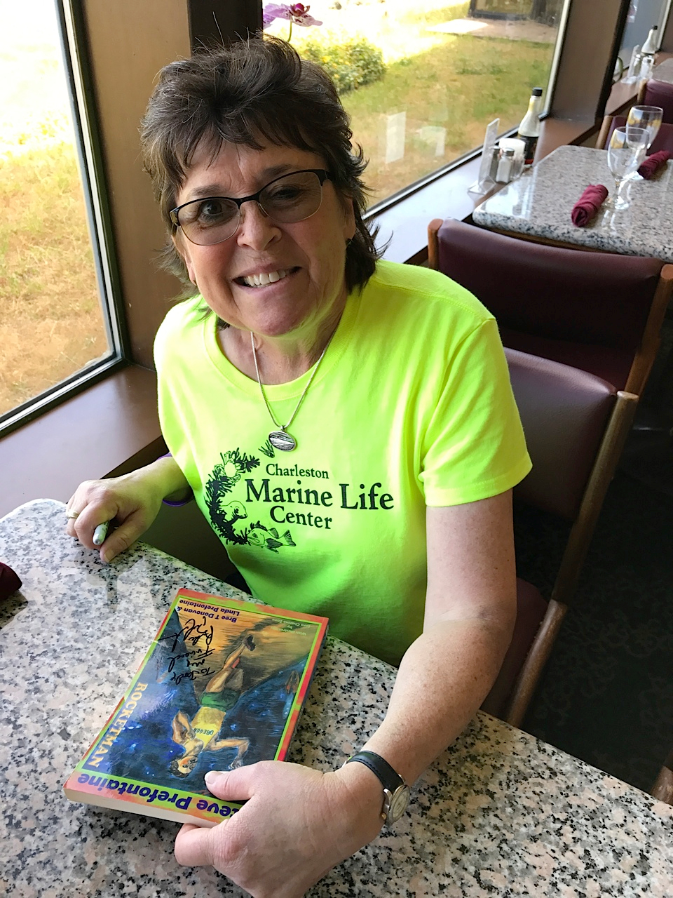 Linda Prefontaine with Signed Book