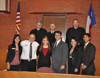 The 10th Court of Appeals poses with staff in the CJ Courtroom.