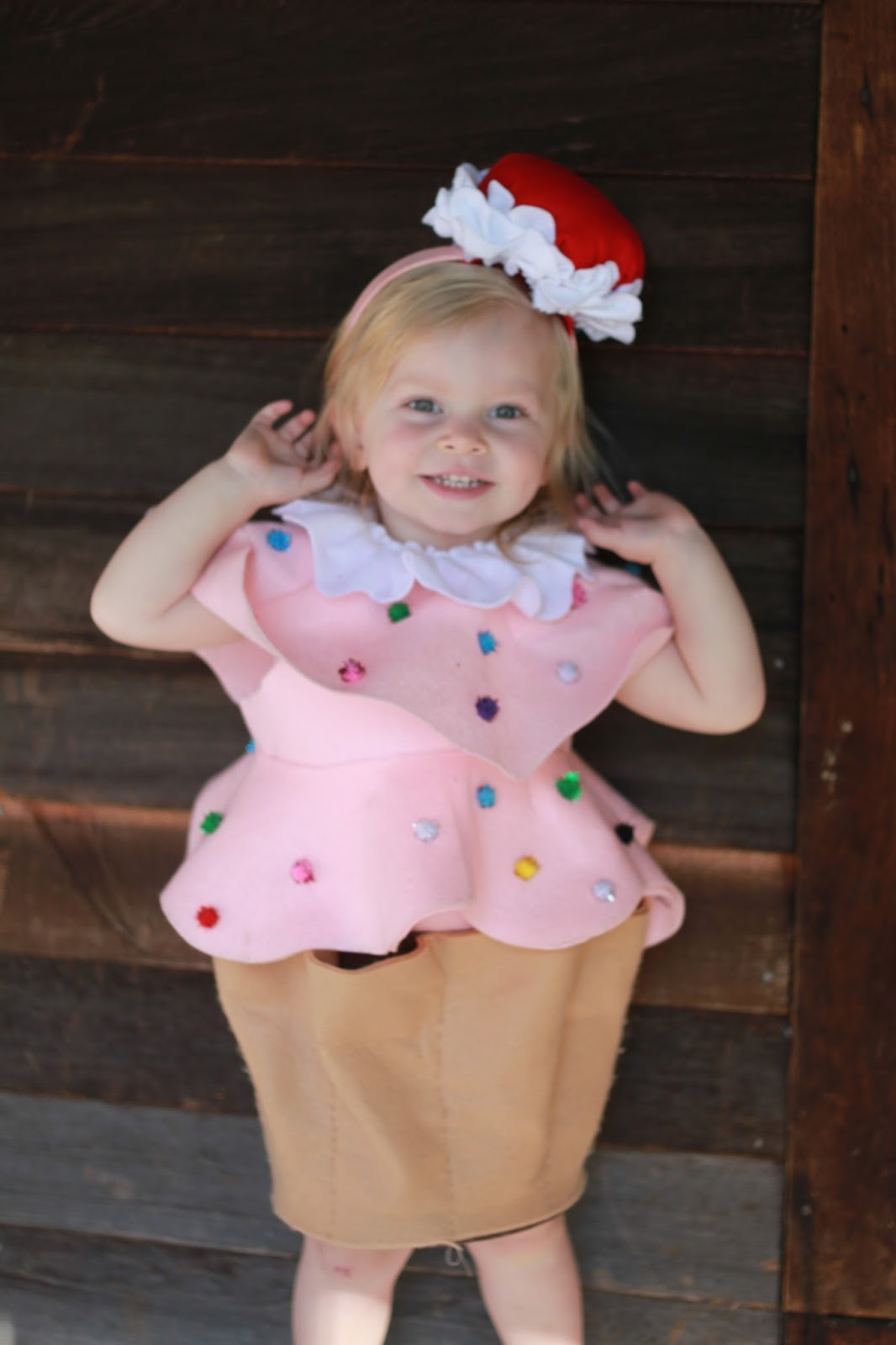 Lennon had a Cherry on top. I assumed it would stay on better. Although I didnu0027t account for the fact that she is younger and has no understanding of ...  sc 1 st  A Young Wifeu0027s Tale & DIY Kids Cupcake Costume. | A Young Wifeu0027s Tale