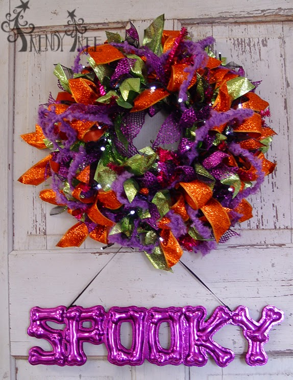 http://www.trendytree.com/raz-christmas-and-halloween-decor/raz-19-bony-spooky-halloween-sign.html