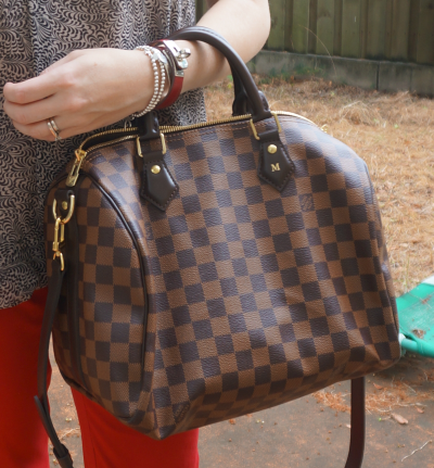 Louis Vuitton Damier Ebene 30 speedy bandouliere worn with red skinny jeans