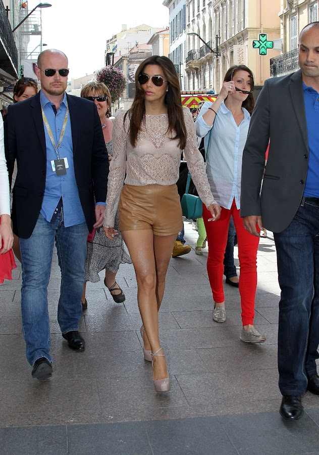 Hot celebrity Eva Longoria in leather shorts at Cannes Film Festival 2012