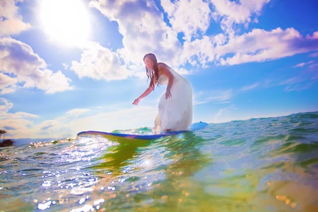 bride surfing in her wedding dress, destination maui weddings, top maui wedding ceremony destinations