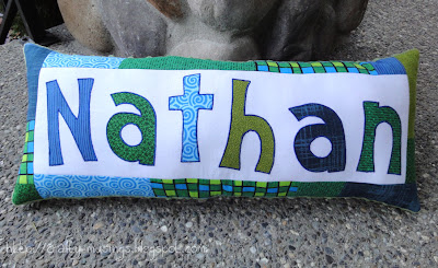 Nathan's happy blue/green pillow, front view