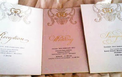 photos of pink and gold wedding invitation card of riteish deshmukh and genelia dsouza's interfaith marriage
