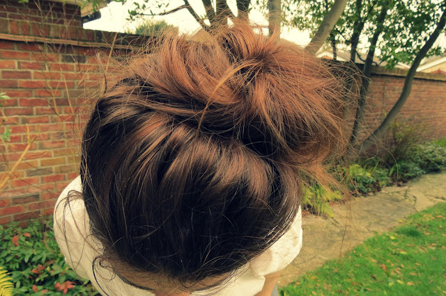 a photo of a messy bun hairstyle as seen in vogue