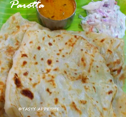 Parotta recipe indian layered bread recipe tasty dinner ideas parotta indian layered bread the very thought of soft flaky parotta with hot spicy salna gives waterymouth its a gem among south indian dinner forumfinder Image collections