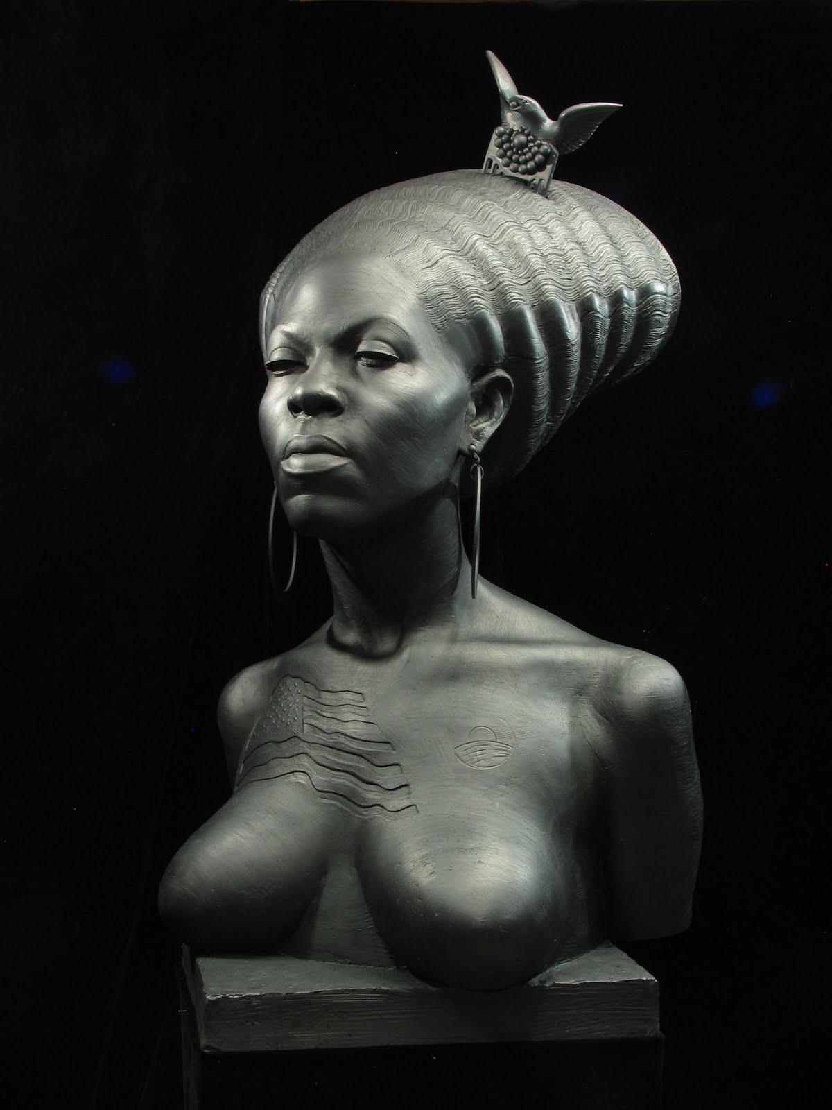 http://4.bp.blogspot.com/-zG4LZ9d1U-I/Ti9-Sx6CqqI/AAAAAAAADs0/H_wYm-OUN6w/s1600/sculptor+Daniel+Edwards%2527+portrayal+of+Michelle+Obama.jpg