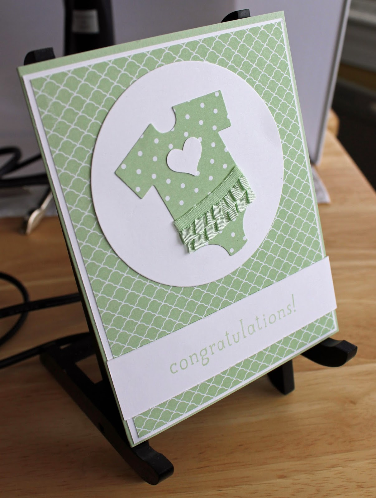 This baby card uses framelits and the Big News set from Stampin' Up!