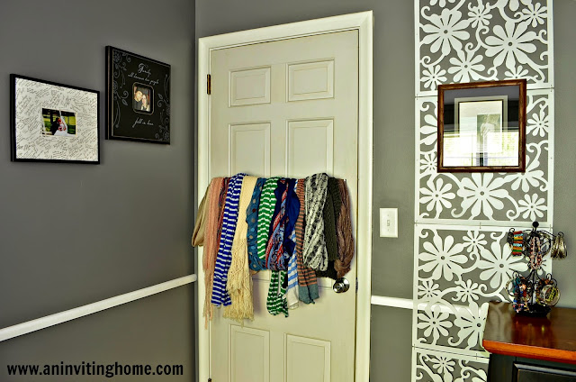 use a towel bar to organize scarves