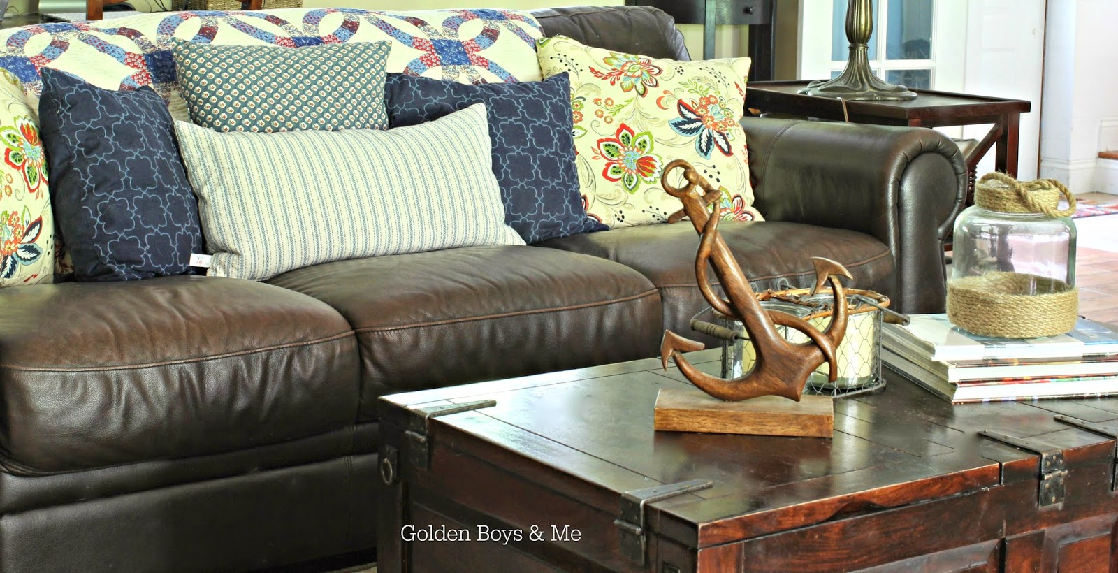 Brown leather sofa with quilt in Americana family room-www.goldenboysandme.com