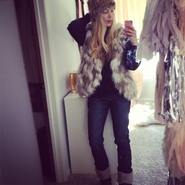 faux fur vest and jeans