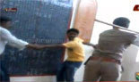 Woman police attacking youths in custody In Karnataka is caught on tape
