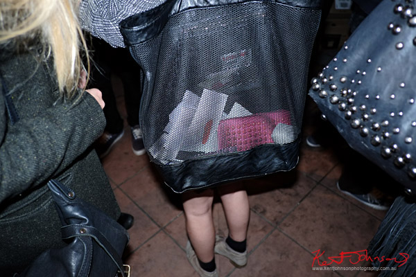 Bags at an art opening; Leather, mesh with contents, studded bag. Sydney Style.