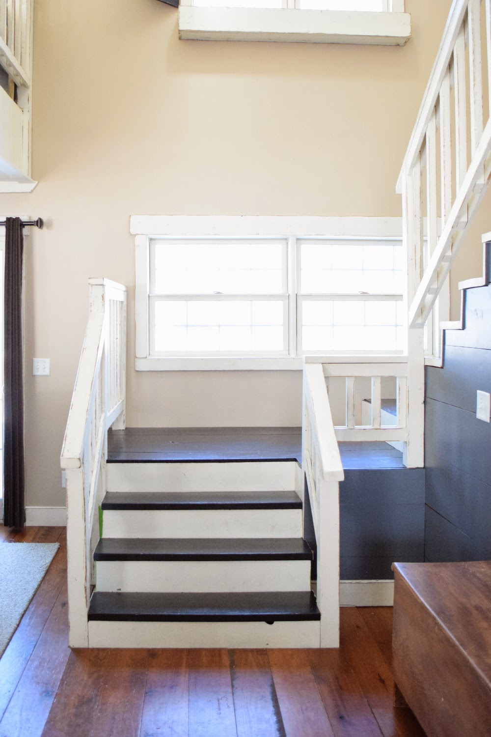 before and after: brown stairs painted black. paintthebarnred.com